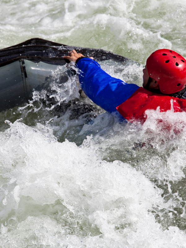 Rapids Man Reaching for Boat